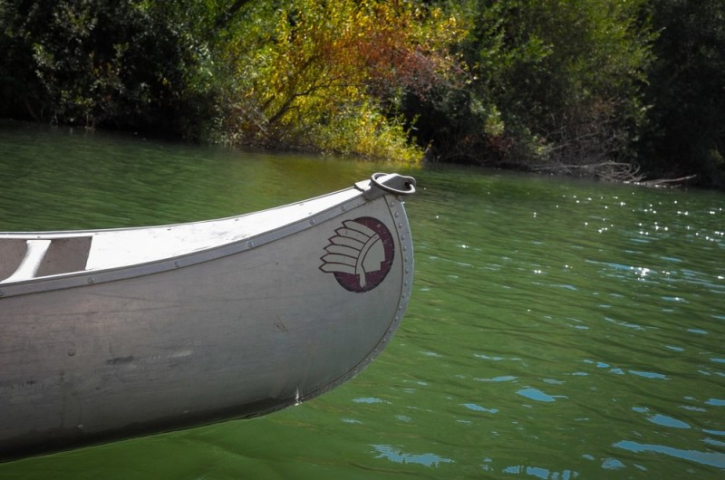 Canoe from Burke's Canoe Trips heading out on the Russian River. (Image via Yelp)