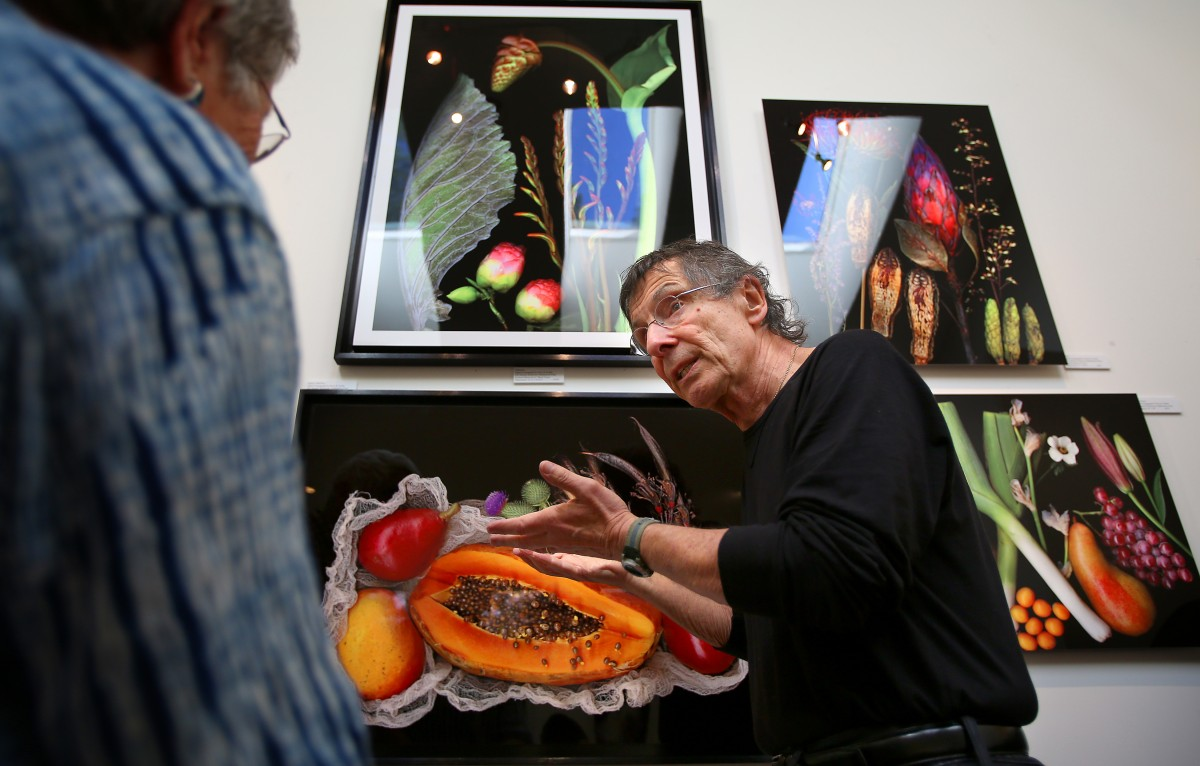 Artist Peter M. Krohn, right, talks with Judy Mathieson about his scanography of botanicals on aluminum in his studio, during the Sonoma County Art Trails Open Studio Tour, in Sebastopol on Sunday, October 12, 2014. (Christopher Chung/ The Press Democrat)