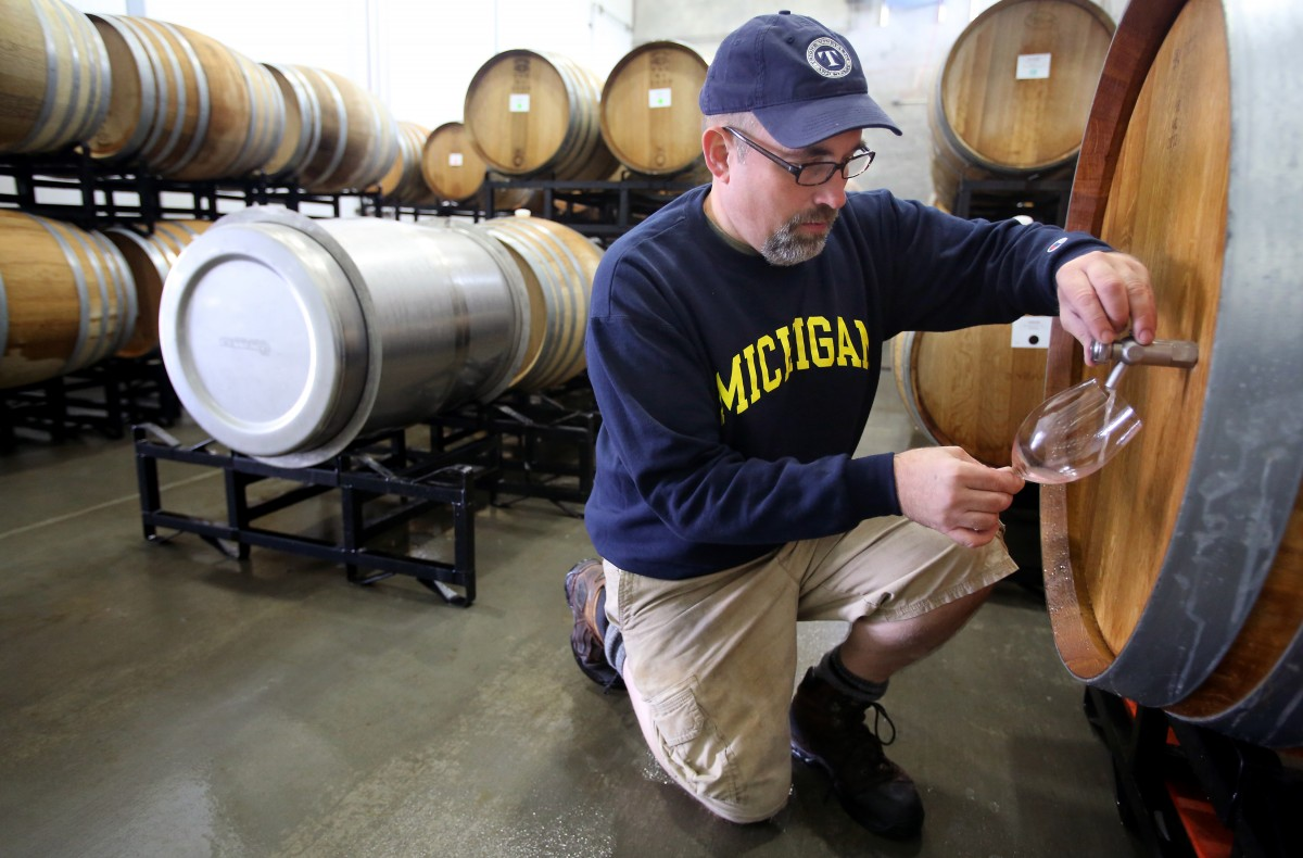 Winemaker Scot Covington samples wine from a barrel at Trione Vineyards and Winery, in Geyserville, on Friday, November 2, 2012. Covington has been making wine with the Trione family since 2005. (Christopher Chung/ The Press Democrat) Christopher Chung