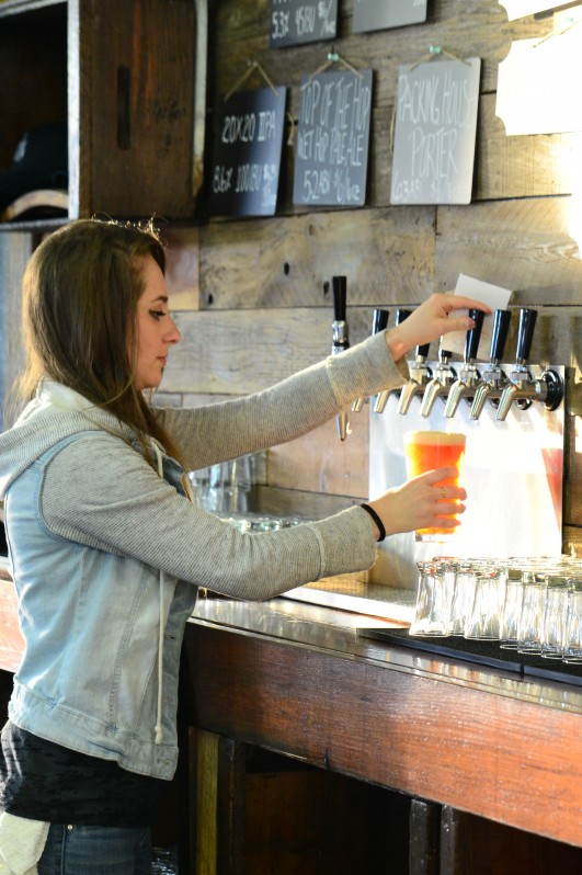 Morgan pouring brews at Grav South Brew Co. in Cotati. (Photo by Tim Vallery)