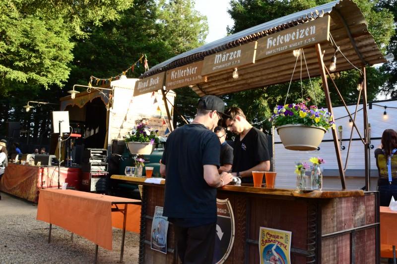 People ordering beer from Gordon Biersch's Oktoberfest bar at Sonoma County's Funkendank Oktoberfest. (Photo by Tim Vallery)