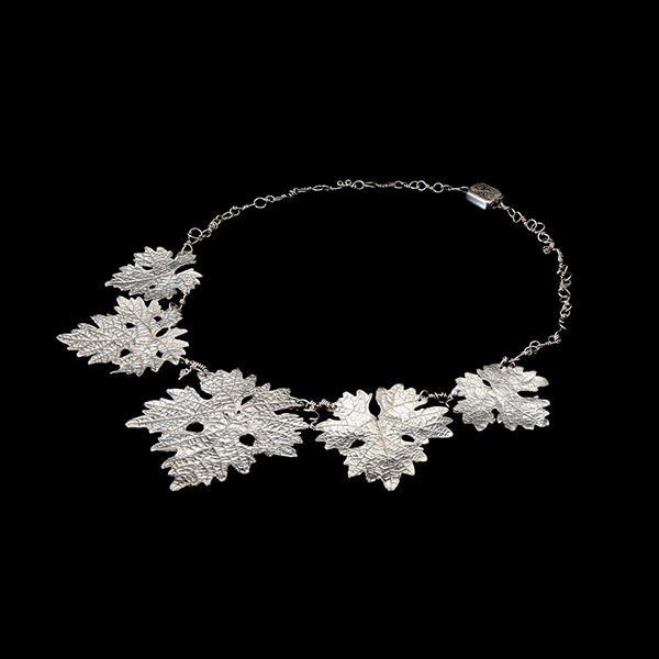 Grape Leaf and tendril chain Necklace. Recycled Fine Silver, Sterling. (Photo courtesy of Michelle Hoting)