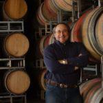 Vintner Greg Graziano with aging wine barrels.
