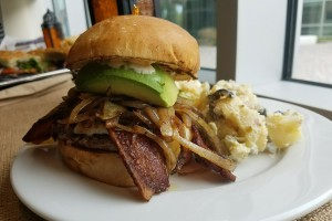 Patty melt with bacon, caramelized onions and avocado with potato salad at Starting From Scratch Cafe in Santa Rosa. Heather Irwin/PD