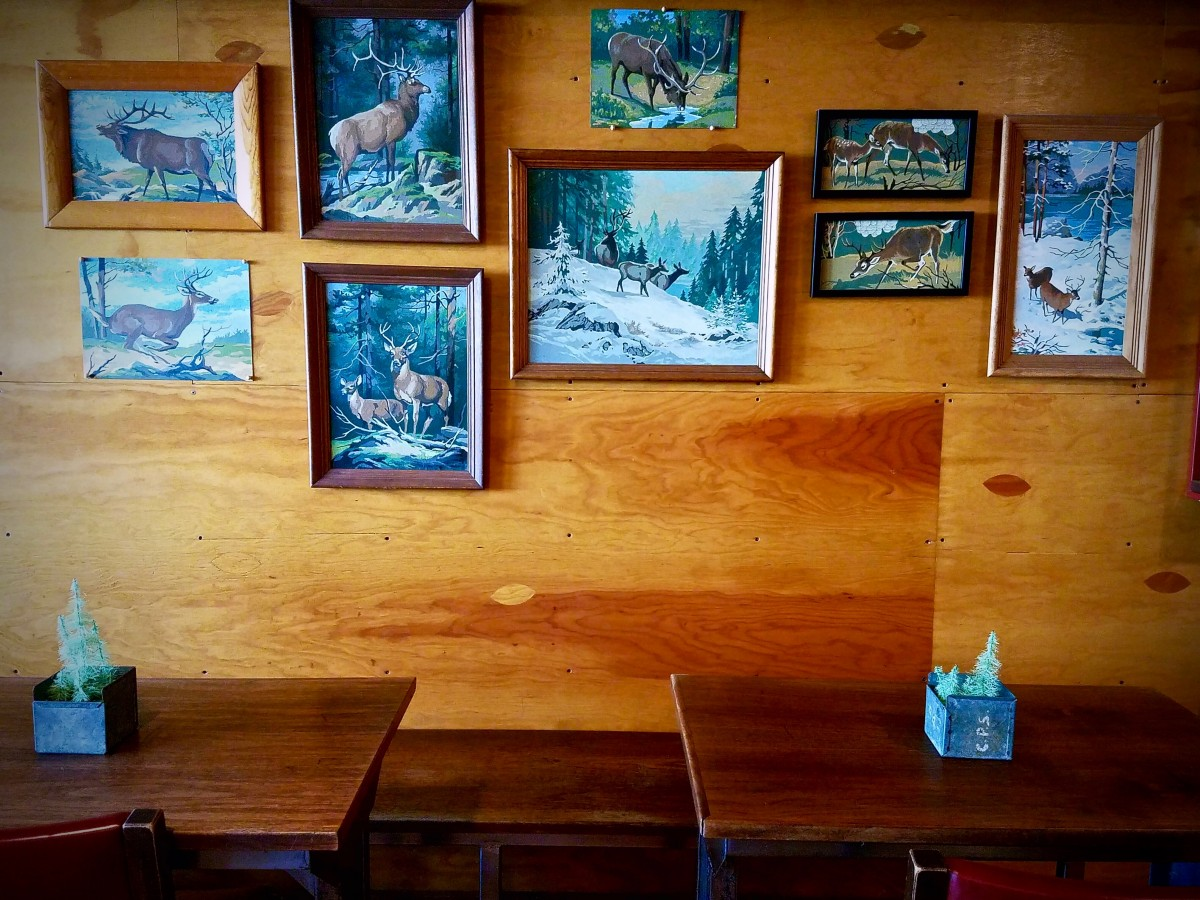 Seating and wall decor at Plank Coffee in Cloverdale. (Photo by Chelsea Kurnick)