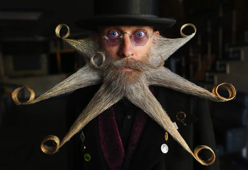 "Aarne Bielefeldt of Willits wears his ""octo-beard"" with his wife Rita wearing her Whiskerina beard made of gears during the 58th annual Bill Soberanes Memorial Petaluma Whiskerino, at the Phoenix Theater in Petaluma, California on Saturday, October 8, 2016. (Alvin Jornada / The Press Democrat) Whiskerino Alvin Jornada"