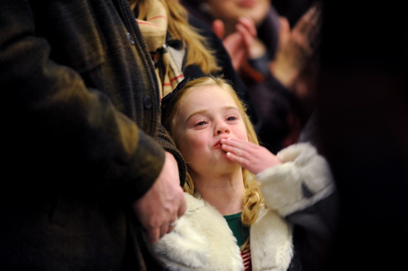 Scarlett Lemieux, 6, of Petaluma, California blowing kisses to Snoopy during the Snoopy ice show and holiday tree-lighting event held Friday evening at the Redwood Empire Ice Arena in Santa Rosa. December 2, 2011 (Photo: Erik Castro/for The Press Democrat)