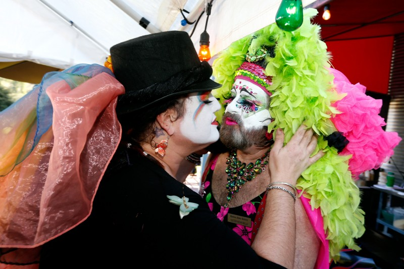 Sister Sara Femme, left, greets Sister Nova Nilla with a kiss during the Russian River Sisters of Perpetual Indulgence Quinceanera at the Rio Theater in Monte Rio, California on Friday, March 25, 2016. (Alvin Jornada / The Press Democrat) Russian River Sisters of Perpetual Indulgence 15th Anniversary