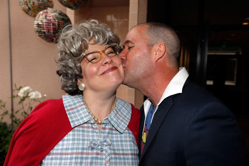 Hunter Wilkinson kisses his wife, SAY chief operating officer Katrina Thurman, in costume as Super-Grandma, during the Here We Come to SAY the Day fundraiser for Social Advocates for Youth, at the Friedman Center in Santa Rosa, California on Saturday, May 14, 2016. (Alvin Jornada / The Press Democrat)