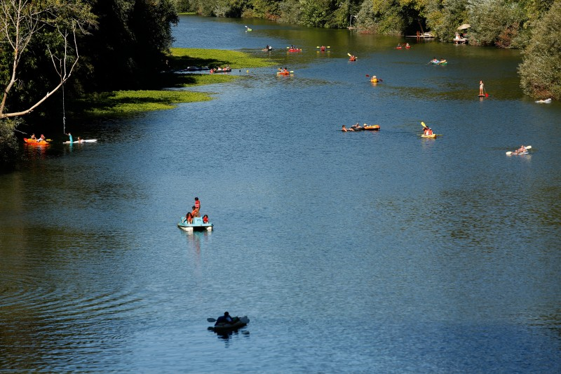People float down the Russian River by various methods of transport towards Johnson's Beach in Guerneville, California on Sunday, September 6, 2015. (Alvin Jornada
