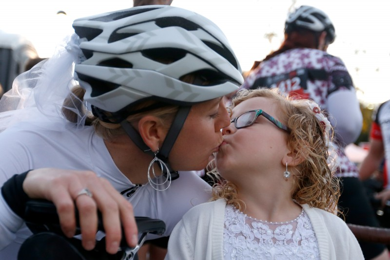 Bride-to-be Katie Excell kisses her daughter and flower girl Caitlynn Cluse, 5, before Excell gets married at Levi's GranFondo, in Santa Rosa, California on Saturday, October 1, 2016. (Alvin Jornada / The Press Democrat)