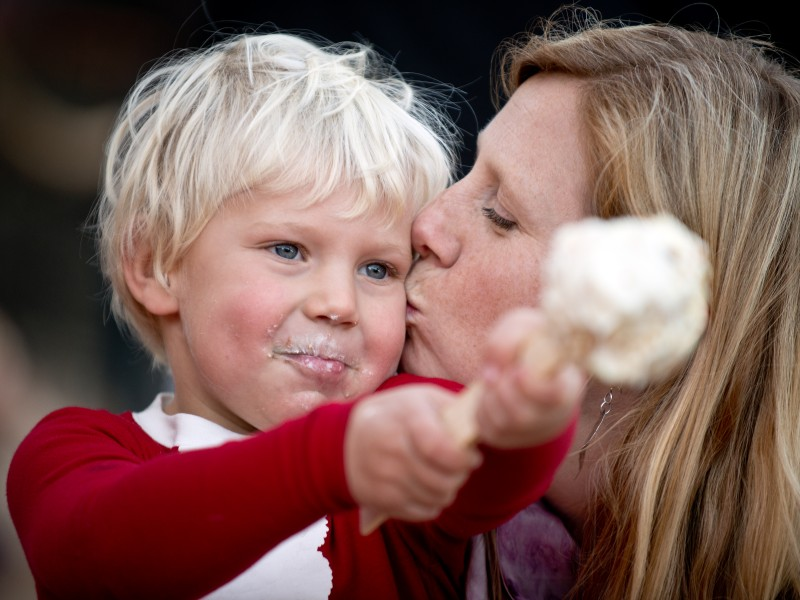 Caleb Wirts, 3, gets a kiss from his mother Erin while he eats his popcorn ball during the Lighting of the Snowmen Festival at Cornerstone Sonoma in Sonoma, Calif., on December 8, 2013. (Alvin Jornada / The Press Democrat) Lighting of the Snowmen