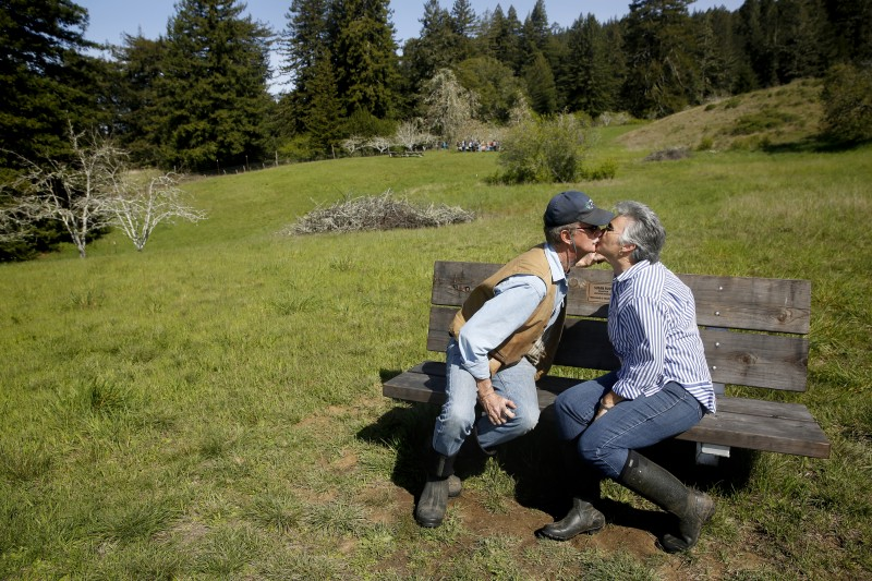 Susan Rudy, Fort Ross Conservancy adviser and lead orchard volunteer, kisses her husband Scott Foster after he donated a bench in her honor at the historic Ft. Ross orchard north of Jenner, on Thursday, March 24, 2016. (BETH SCHLANKER/ The Press Democrat) Ft. Ross Orchard Beth Schlanker