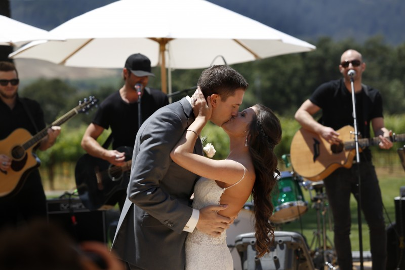 Samantha Carisch and Taylor Sinclair kiss as country music singer Canaan Smith sings their first song during The Knot's Dream Wedding at Chateau St. Jean in Kenwood, on Thursday, June 4, 2015. (BETH SCHLANKER/ The Press Democrat) The Knot Dream Wedding Beth Schlanker