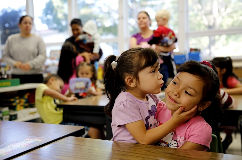 Kindergartener Diana Perez, 5, right, gets a kiss goodbye from her little sister Michelle, 3, before the first day of classes at Geyserville Elementary School in Geyserville, California on Wednesday, August 14, 2013. (BETH SCHLANKER/ The Press Democrat) Geyserville Unified School District