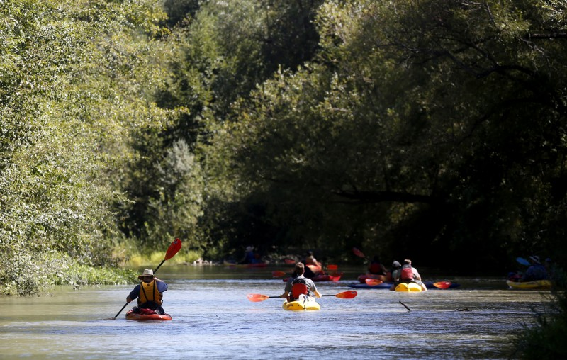 Kayakers on the Russian River. (Photo by Beth Schlanker)