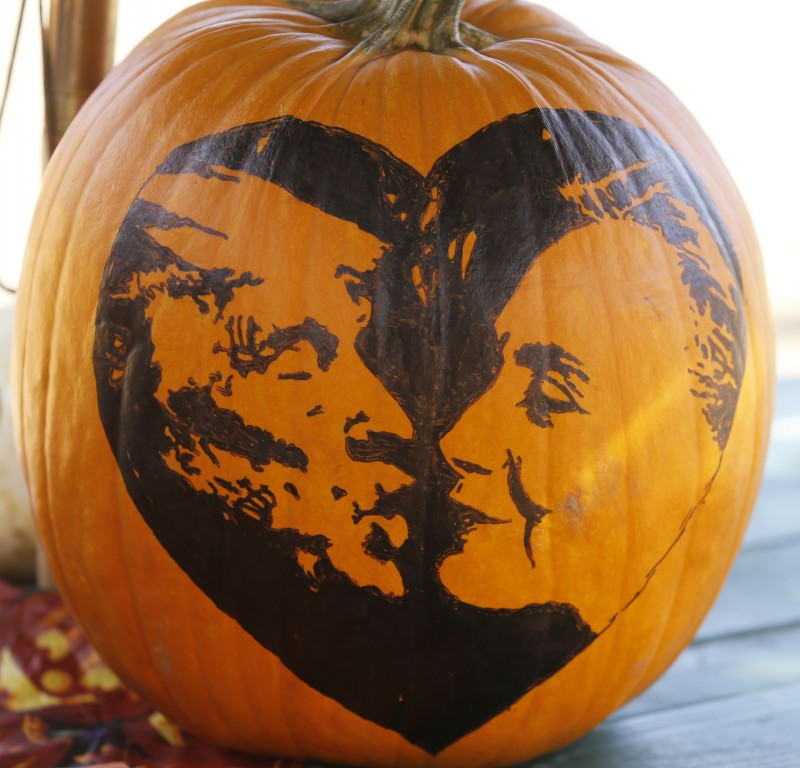 Before carving, Jason Todd drew a humorous design of a kissing Donald Trump and Hillary Clinton onto a pumpkin at Muelrath Ranches pumpkin patch on Sunday, October 23, 2016 in Santa Rosa, California . (BETH SCHLANKER/ The Press Democrat)