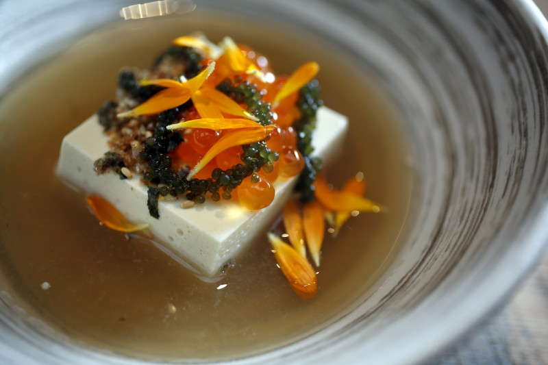 The silken tofu in a chilled shiitake broth, topped with sea grapes, and salmon pearls at Two Birds One Stone in St. Helena. (Photo by Beth Schlanker)