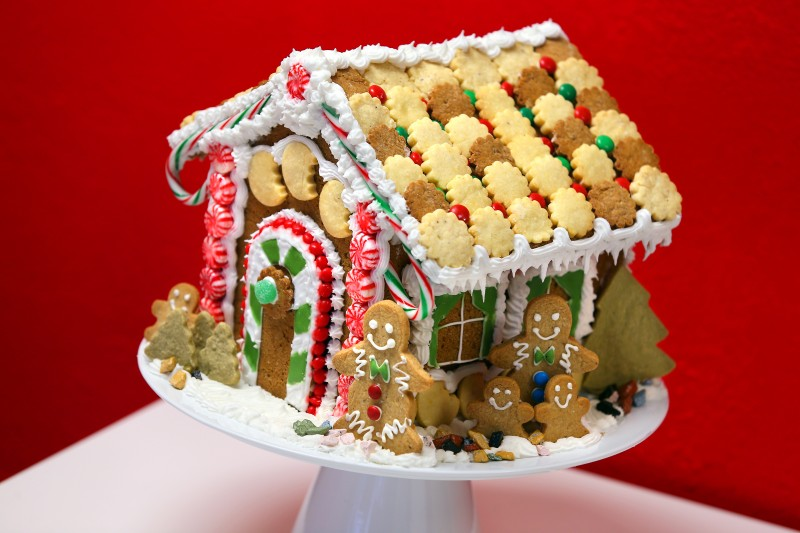 A gingerbread house decorated with cookies, candy and gingerbread men, by Tracy Mattson, owner of Cookie...take a bite!. (Christopher Chung/ The Press Democrat)