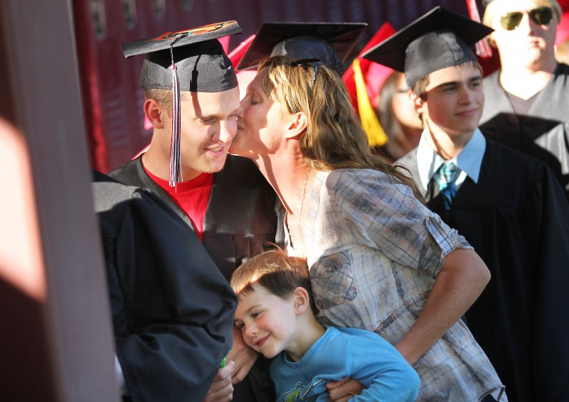 Graduating senior Skyler Hauprich receives a kiss from his mother before walking through El Molino High School's commencement ceremony on Thursday, May 30, 2013. (Conner Jay/The Press Democrat) El Molino High School graduation