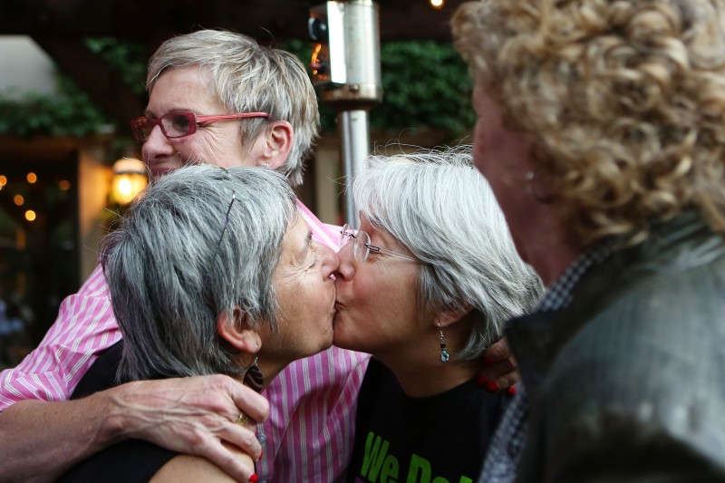 PC: Joan Longfeld, left, and Susie Jungfaru kiss while while celebrating the Supreme Court rulings restoring same-sex marriage to Californians during a celebration in Healdsburg on Wednesday, June 26, 2013. Longfeld and Jungfaru have been tried to get married in 2004 and then again in 2008, and have been together for the past 35 years. (Conner Jay/The Press Democrat)