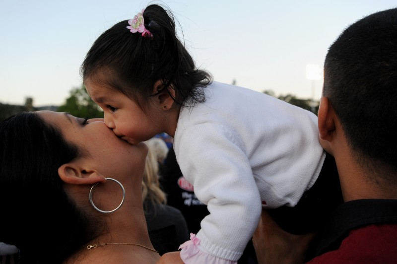 Sixteen-month-old Brittany Morales kissing her aunt Zenaida Morales during the Cloverdale High School 2010 graduation ceremony Friday evening. May 28, 2010. (Photo: Erik Castro/for The Press Democrat)