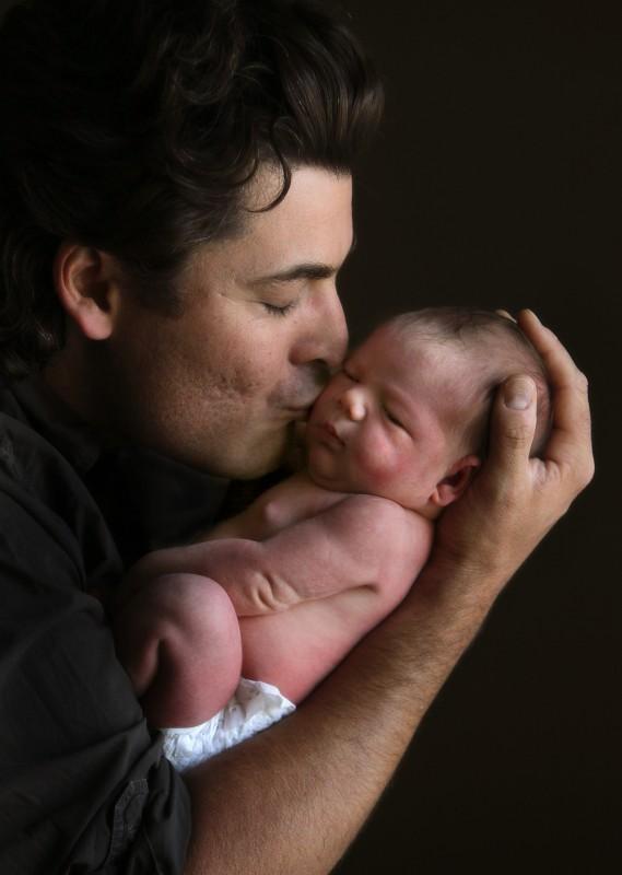 New father Miguel Soria, left, kisses his day-old daughter Raquel. John Burgess/The Press Democrat