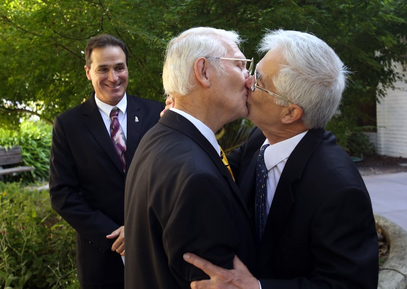 Ed Mason, left, of Larkfield, kisses his partner of 46 years, Barry Hong, after Sonoma County Clerk Bill Rousseau completed their marriage ceremony in Santa Rosa on July 1, 2013. (photo by John Burgess/The Press Democrat)