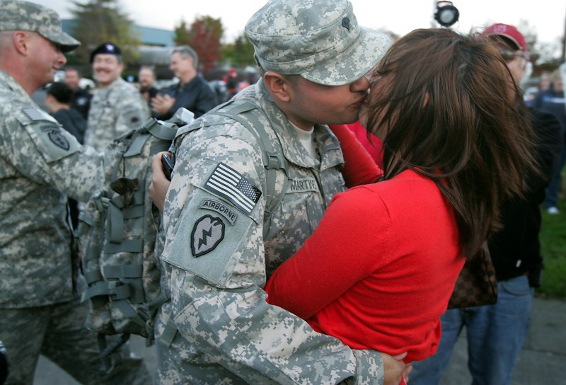 pecialist Carlos Martinez kisses his girlfriend Melanie Chhy in front of the Petaluma Armory after spending a year in Afghanistan with the California National Guard's 235th Engineer Company. John Burgess