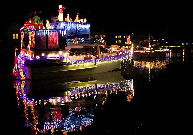 The Petaluma Lighted Boat Parade cruised into the downtown turning basin on Saturday, December 13, 2014. (photo by John Burgess/The Press Democrat)