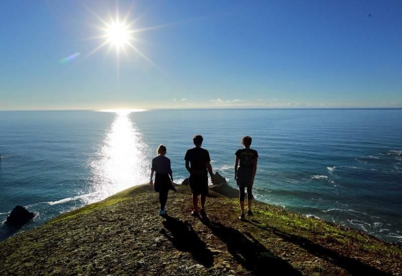 Friends taking a hike along the Sonoma Coast. (Photo by John Burgess)