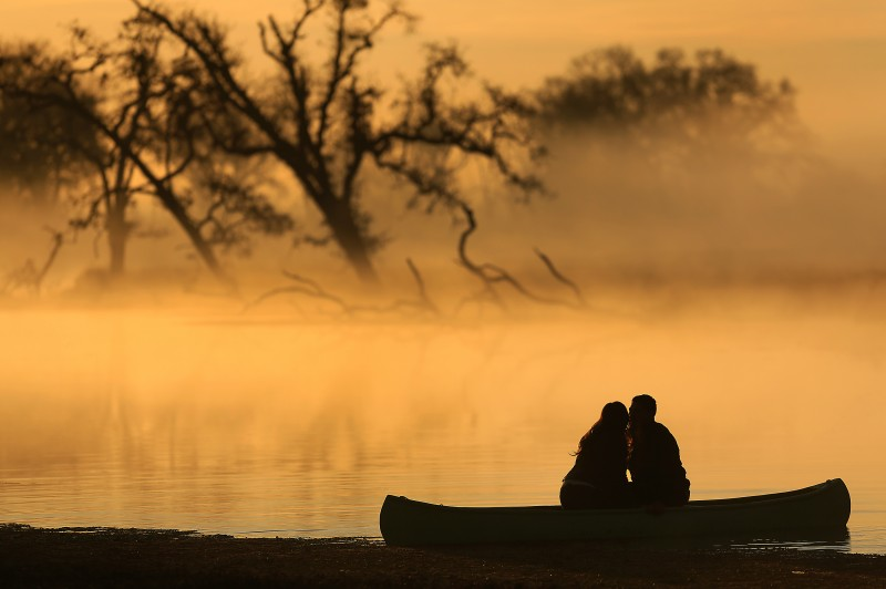 Britney Wehrfritz, left and Steve Nemecek of Sebastopol share a kiss as a friend takes their engagement photo at the Laguna de Santa Rosa, early Friday morning Jan. 10, 2013. (Photo by Kent Porter)