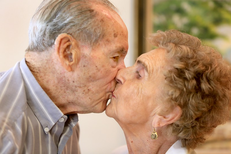 Calvin, 96, and Gladys Purvis, 93 smooch, Monday July 27, 2015 in Santa Rosa. The two will be celebrating their 75th wedding anniversary this week. (Kent Porter / Press Democrat)