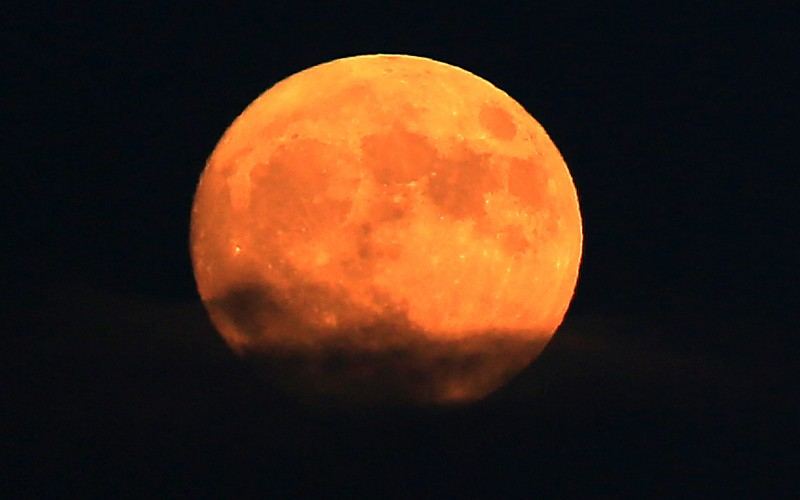 Yellow from airborne particulates, the super moon rises, Sunday Nov. 13, 2016, photographed from Santa Rosa (Kent Porter
