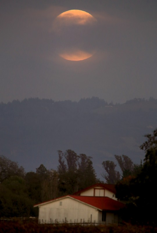 Obscured by clouds, the super moon rises, Sunday Nov. 13, 2016, photographed from Santa Rosa (Kent Porter