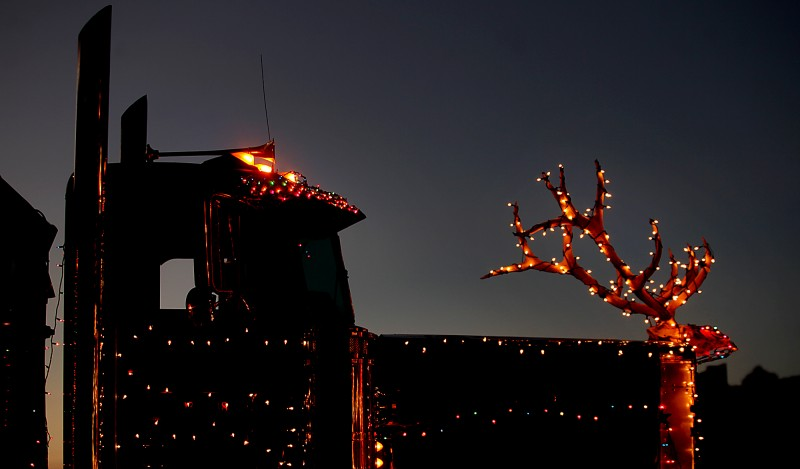 Antlers were added, Saturday Nov. 24, 2012, to a gravel truck prior to the Geyserville tractor parade . The parade included farm equipment, fire trucks and tractor trailer rigs. (Kent Porter / Press Democrat) 2012 Kent Porter