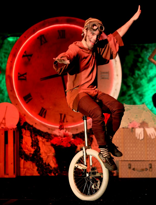 Le Cirque de Bohme unicycler Colin Creveling entertains a crowd under the big top at Cornerstone Gardens in Sonoma, Saturday Dec. 26, 2015. (Kent Porter)