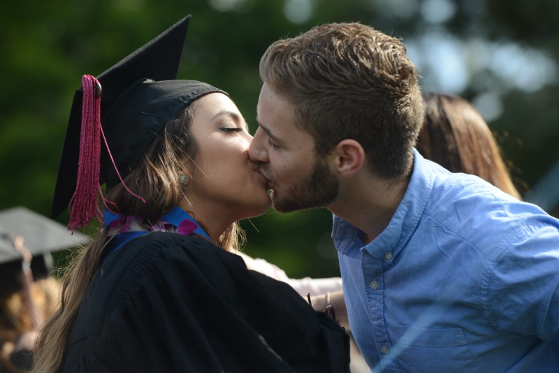 """I know how hard she has worked for this,"" said Nicolas Carjuza, right, after kissing his girlfriend Michelle Welling, left, during the Sonoma State University commencement ceremony for the class of 2015 held Saturday morning at Rhonert Park. May 16, 2015. (Photo: Erik Castro/for The Press Democrat)"