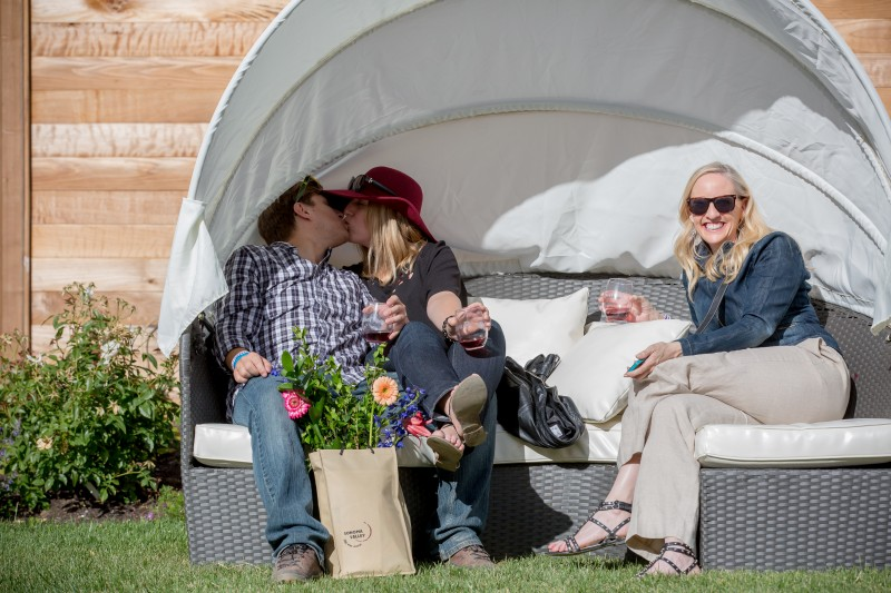Clinton Tjensvold and Christie Pitts kiss while Karen Zachary smiles during Sunset Magazine's Celebration Weekend at Cornerstone near Sonoma, Calif. Saturday, May 14, 2016. Guests were invited to join editors, celebrity chefs, vintners, craft beer brewers and lifestyle experts for a two-day series of culinary, wine, garden and lifestyle events. (Jeremy Portje / For The Press Democrat) Jeremy Portje