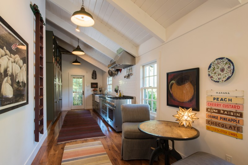 The high ceiling lends an airy feel to the compact gallery kitchen.