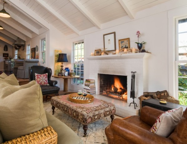 The great room is warmed by the house's original fireplace.