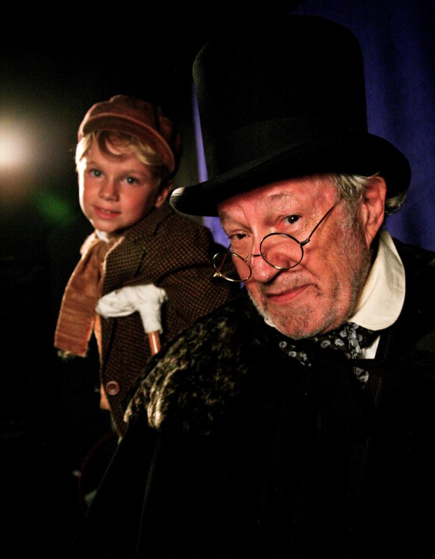 Scrooge (Charles Siebert) with Tiny Tim (James Coté)