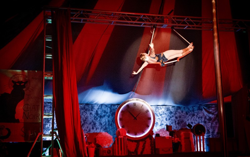 Cola Claret of Le Cirque de Bohme performs on a trapeze under the big top at Cornerstone Gardens in Sonoma, Saturday Dec. 26, 2015. (Kent Porter)