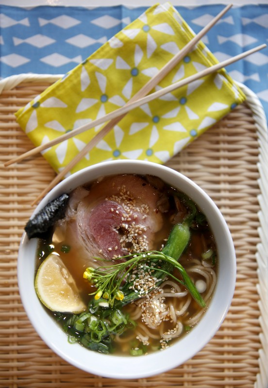 A bowl of homemade ramen soup topped with sliced pork belly, bok choy, maitake mushrooms, scallions, chives, nori (dried seaweed), an yuzu wedge, and sesame seeds, at a ramen workshop at SHED in Healdsburg, on Sunday, October 30, 2016. (BETH SCHLANKER/