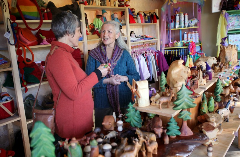 Christine Schreier, right, helps customer Christine Badura in the recently opened store Circle of Hands - a Waldorf Collective, in Sebastopol on Friday afternoon, March 2, 2012. Christopher Chung