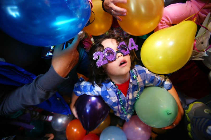 "HIGH-NOON EXCITEMENT: Young guests at the Charles M. Schulz Museum ring in the new year early with balloons and soda during Tuesday's ""Happy New Year, Charlie Brown!"" event."