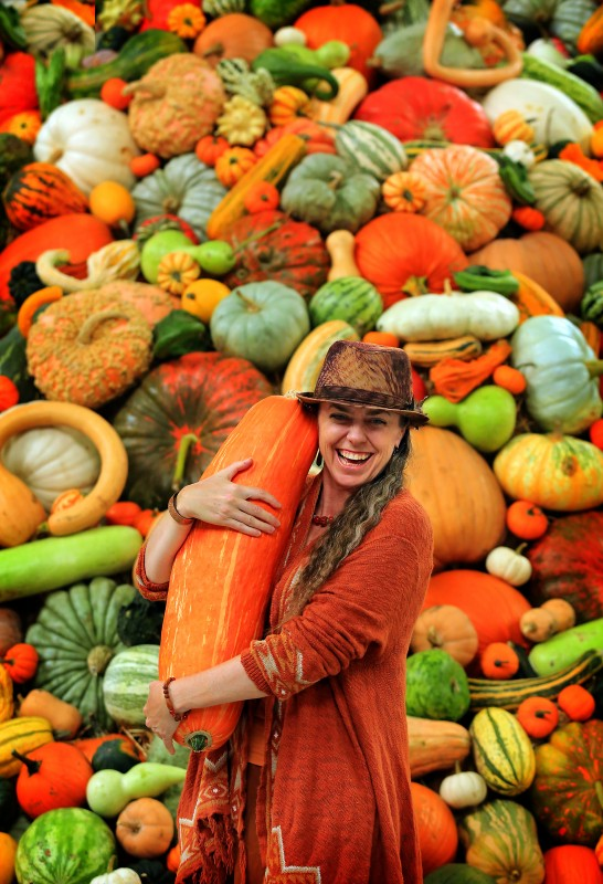 Shawna Kelly of the east bay holds a gete-oskosomin squash grown from ancient found seeds at the 2015 National Heirloom Exposition at the Sonoma County Fairgrounds. (JOHN BURGESS / The Press Democrat)