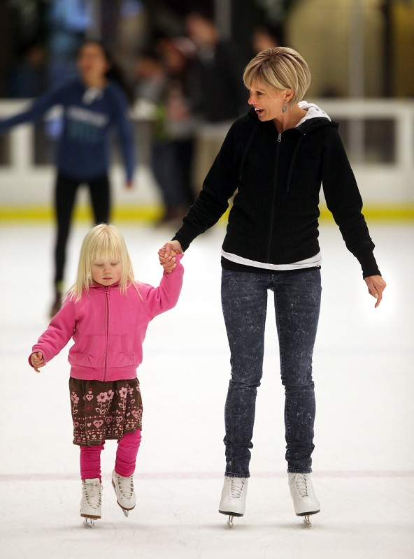 Rachel Vaden of Santa Rosa skates with her daughter Maren, 3, at Snoopy's Home Ice during a family skating session. (John Burgess