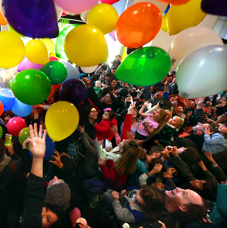 "undreds of children and their parents watch balloons drop at noon Wednesday at the Charles M. Schulz Museum's ""Happy New Year, Charlie Brown!"" celebration in Santa Rosa. The museum hosted a second session of the popular party three hours later."