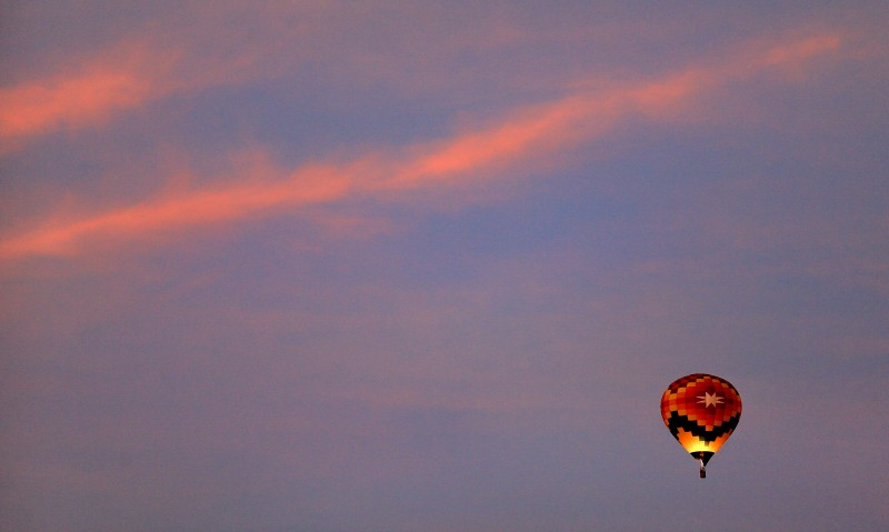 A hot air balloon ascends over Windsor at dawn. (Kent Porter)